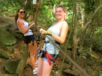 Hayley and I balance on a wire hanging on to a rope