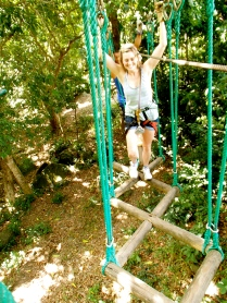 I'm laughing while I balance and move from wooden swing to the next