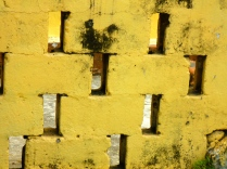 A yellow wall adds colour to a Tortola street