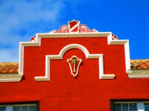A Palm tree motif on a red Northwood Village building