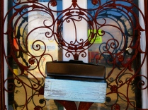 A decorative iron gate and mail box in Northwood Village, West Palm, Florida