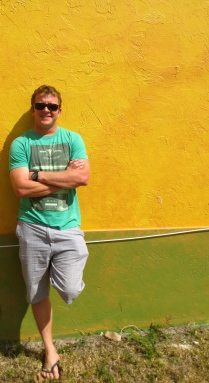 Rich against a yellow and green wall in Northwood Village, West Palm, Florida
