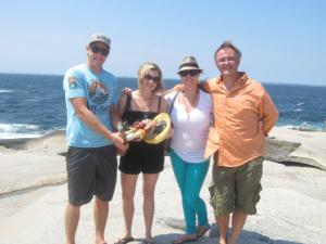 Ryan, Clancy, Cedric and I pose with Frederick at Peggy's Cove, Nova Scotia