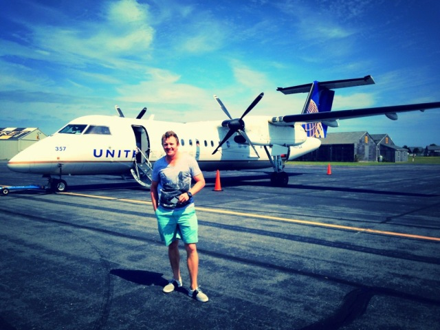 Rich standing in front of our little United flight