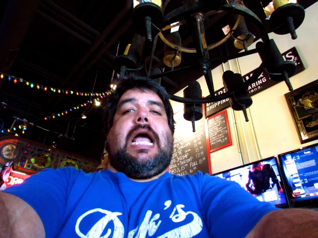 Our 'Dick' waiter hijacking my camera