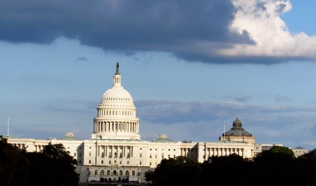 The Capitol Building beneath purple rain clouds