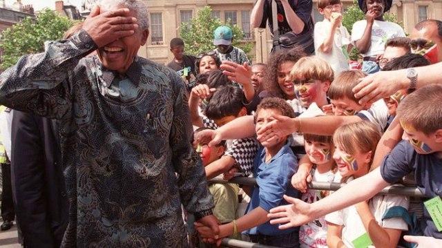 Tata Madiba greets the young Rainbow Nation. Dave Caulkin - AP