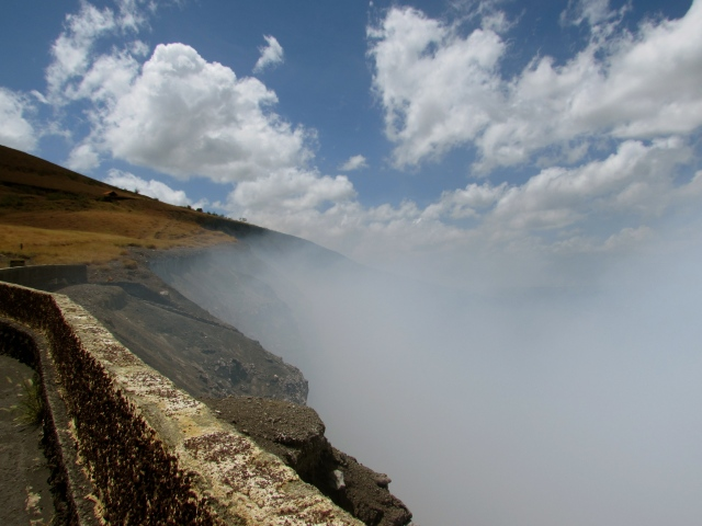 The sulphur volcano smoke floats up towards the clouds