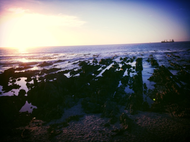 Low tide rock formations along the Sea Point promenade