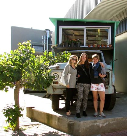 Al, Lou and I posing in front of a truck/ flower container shop in Maboneng